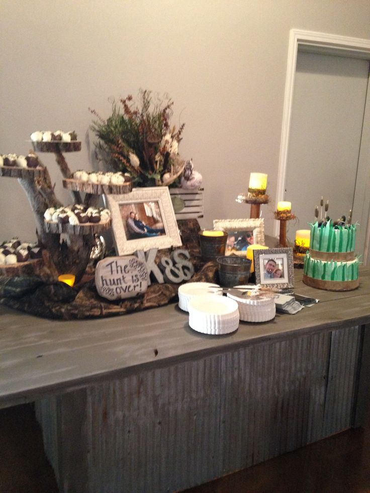 Hunting theme grooms table.  It was the hit of the wedding!!