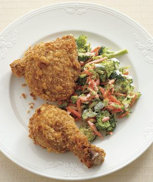 Oven-Fried Chicken With Crunchy Broccoli Slaw recipe: Dip chicken in paprika-spiked buttermilk, coat in crushed buttery crackers, and bake in the oven for a golden, crispy crust—no deep-frying required.