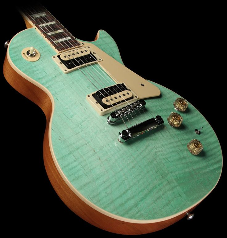 Absolutely gorgeous. Favorite finish I have ever seen on an electric guitar: Gibson Les Paul Classic Electric Guitar Seafoam Green |