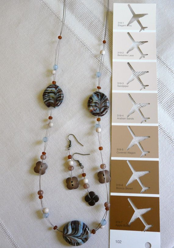 Brewing a unique look this necklace set has glass by PlaneNSimple