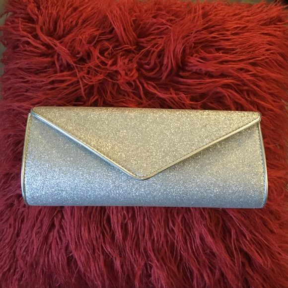 Silver Sparkly Prom Clutch Sparkly clutch I got from Payless Shoes. Used twice. Bags Clutches & Wristlets