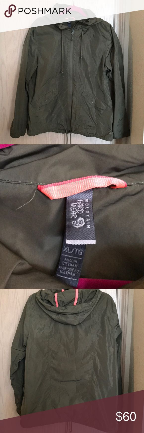 Mountain hardwear rain jacket Mountain hardwear jacket for rain and wind protection. Has been worn but in good condition. Great color and has drawstrings to pull in closer. The hood can be zipped back up if not in use. Has a pink/salmon color accents but subtle. Mountain Hardwear Jackets & Coats