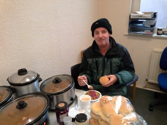 Peter Bentham, one of our learners,  takes a break from computers to enjoy a delicous bowl of hotpot and red cabbage.