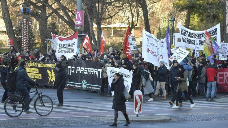 Austria's new coalition government, which includes the far-right Freedom Party, was sworn in on Monday as demonstrators protested outside.
