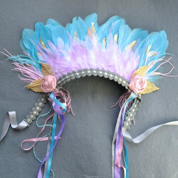 Powder blue, gold-dipped white, and lilac feathers form the base of this headdress, and at the sides I have added fluttering ostrich plumes in blue and