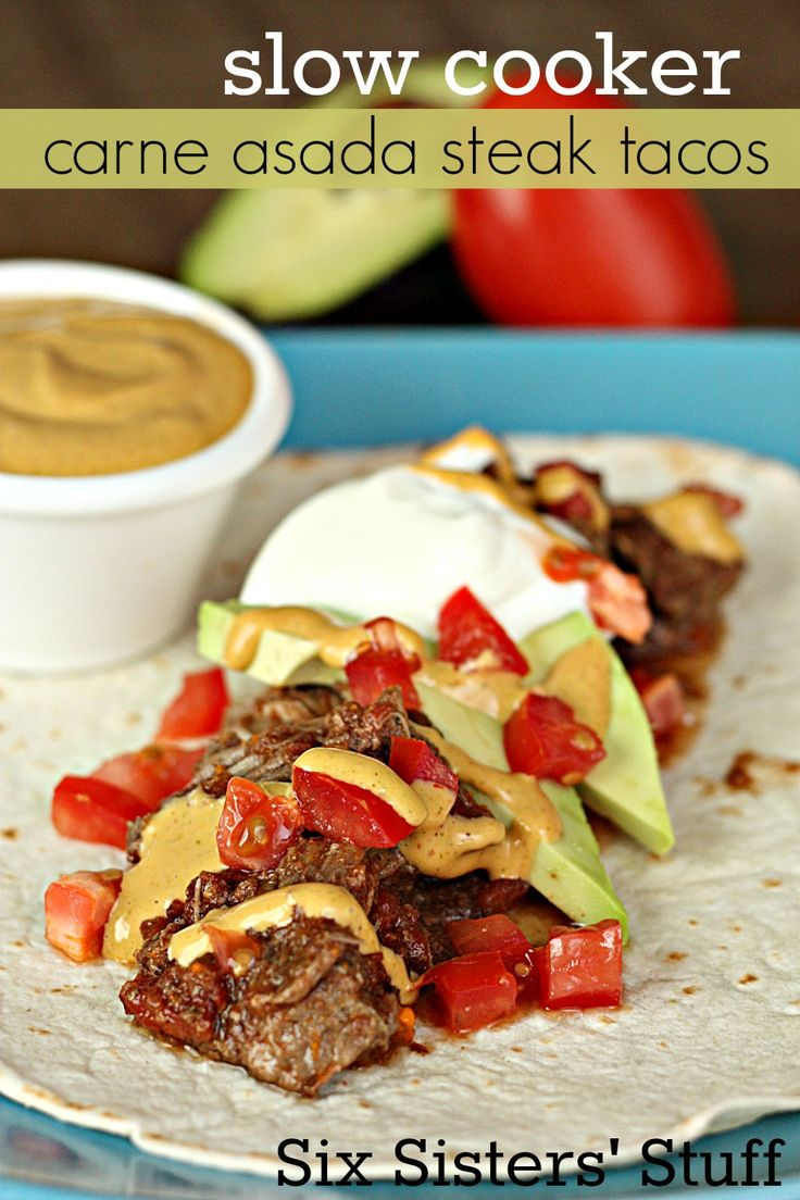 Slow Cooker Carne Asada Steak Tacos (with Chipotle Aioli Sauce)- a quick and easy dinner that is totally restaurant-worthy! SixSistersStuff.com