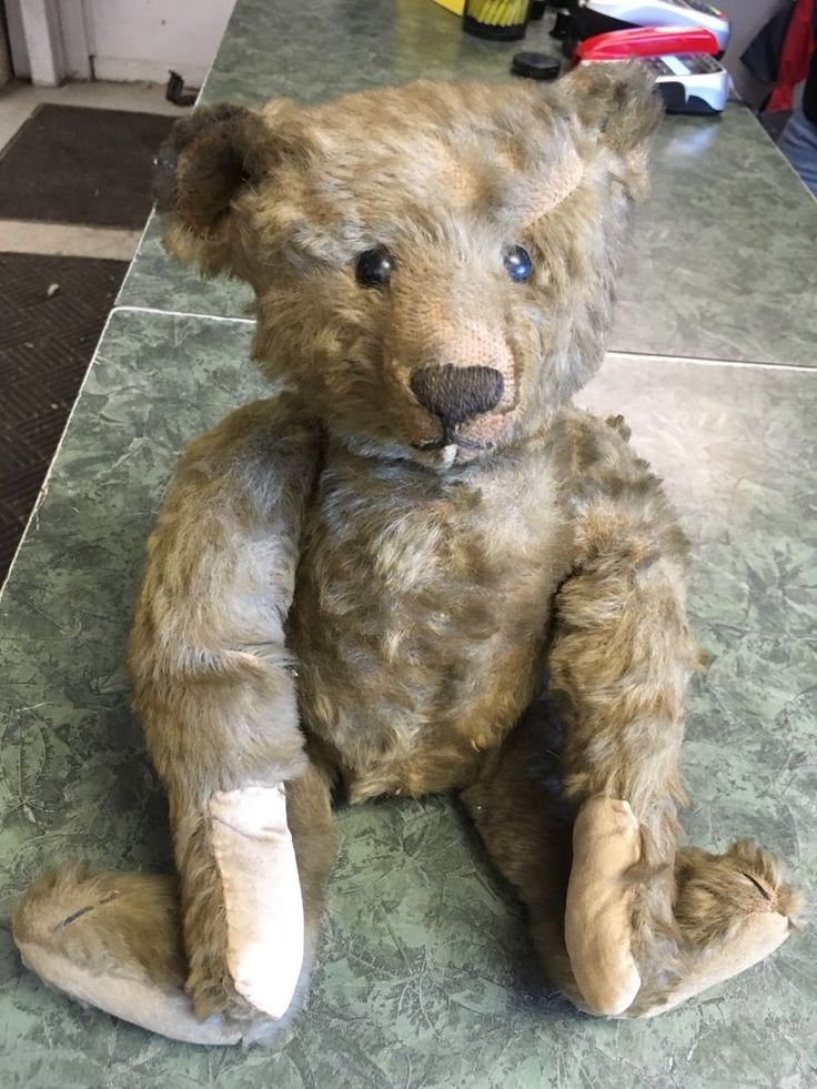 """This is a steiff bear pre 1912 based on the button and the size of the button. He is about 16"""" standing and has wear. Needs a bath, but dosen't seam to have any tears. His arms all move. He is also well stuffed and has something moving on the inside so i can't tell what it is. He was found with a picture of his owner which is included. 