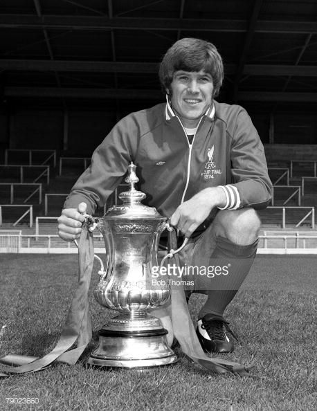 Sport Football England August 1974 Liverpool FC Photocall Liverpool FC's Emlyn Hughes is pictured with the FA Cup trophy that his side won against Newcastle United