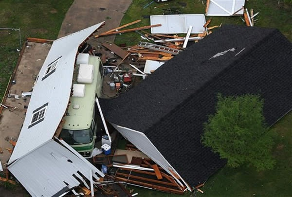 A structure in Arlington, Texas, is destroyed after a tornado hit on Tuesday, April 3, 2012.    AP Photo/The Fort Worth Star-Telegram, Khampha Bouaphanh