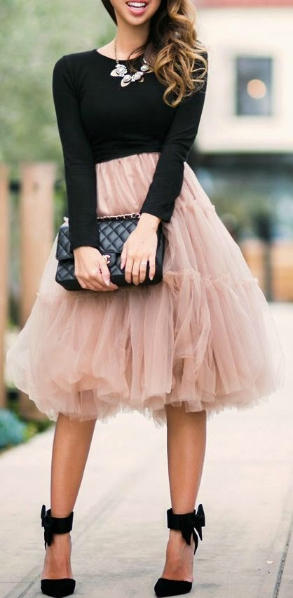 Love this blush color and black sweater paired together.