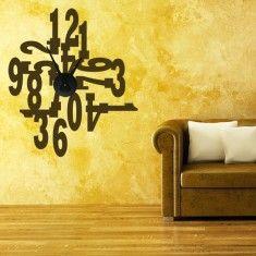 divertidos relojes de pared diseñados con vinilos decorativos. Elige el color que más te guste y verás que bonito queda en tus paredes
