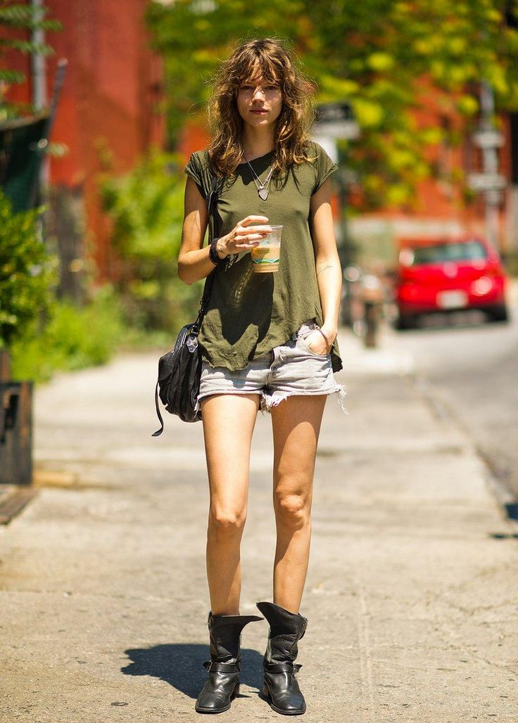 Street style star Freja Beha Erichsen in an olive green tee, white frayed shorts and combat boots