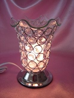 Crystal Oil Burner, Oil Burner, Plugin Oil Burner, Electric Oil Warmer, Oil Warmer, Tart Warmer, Electric Oil Burners, Buy Oil Burners  Beautiful crystal oil burner, tart warmer, candle wax warmer made with crystal beads that have been soldered together in a a flute/tulip shape on a base which is embed with a touch electric switch sensor and 4 electric cord with a dimmer switch which control the brightness of the light and intensity of the fragrance oil. Also can be used as a night light…