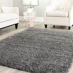 @Overstock.com - Safavieh Cozy Solid Dark Grey Shag Rug - Enjoy the feeling of luxury every day when you add this dark gray shag rug to your decor. Crafted of durable polypropylene, this power-loomed rug features a plush pile for soft comfort and stunning beauty that will stand out in any room.  http://www.overstock.com/Home-Garden/Safavieh-Cozy-Solid-Dark-Grey-Shag-Rug/7322535/product.html?CID=214117 $53.99