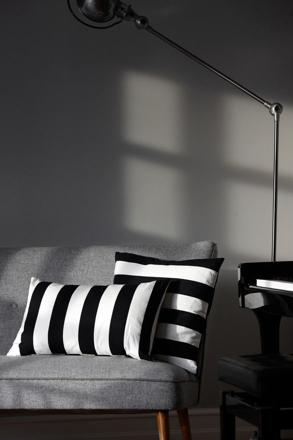 KR Pillow    Two types of black and white cotton pillows, 60x35 cm and 50x50 cm. Down filling and folded back.