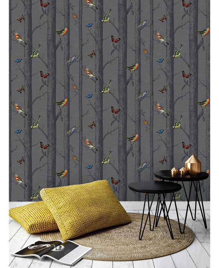 This stunning Birds on Branches Wallpaper features a detailed collection of beautiful birds and butterflies in rich vibrant colours, set on a forest themed background of trees and branches in dark grey tones.