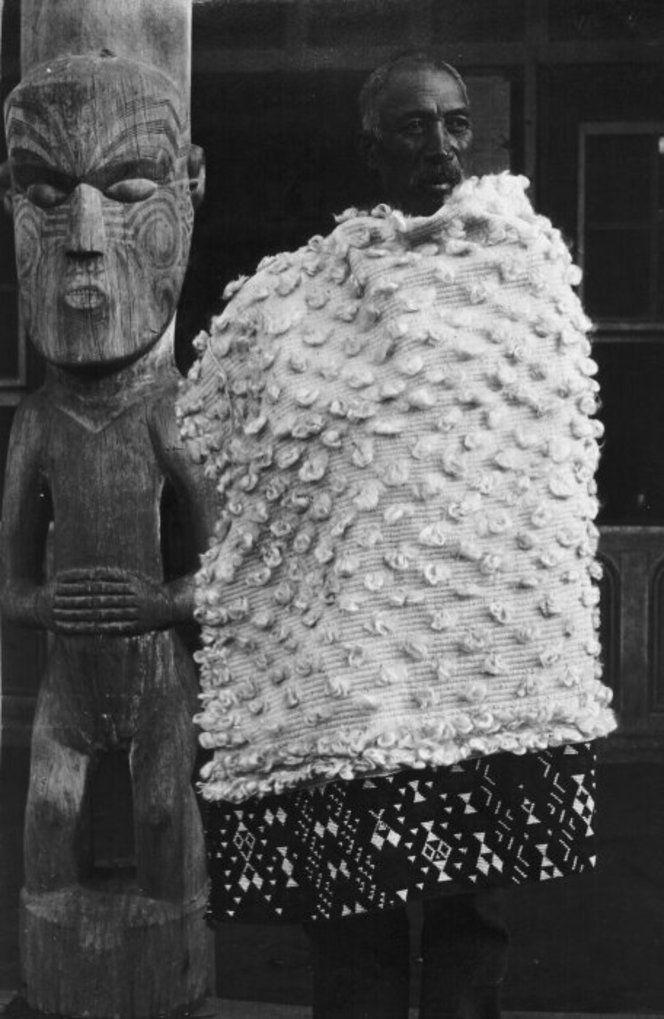 Pokiha modeling a fine flax cloak decorated with taniko, at Koroniti