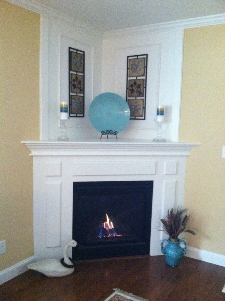 What to do with a corner fireplace (I designed this)..ps: the goose was NOT my idea, lol