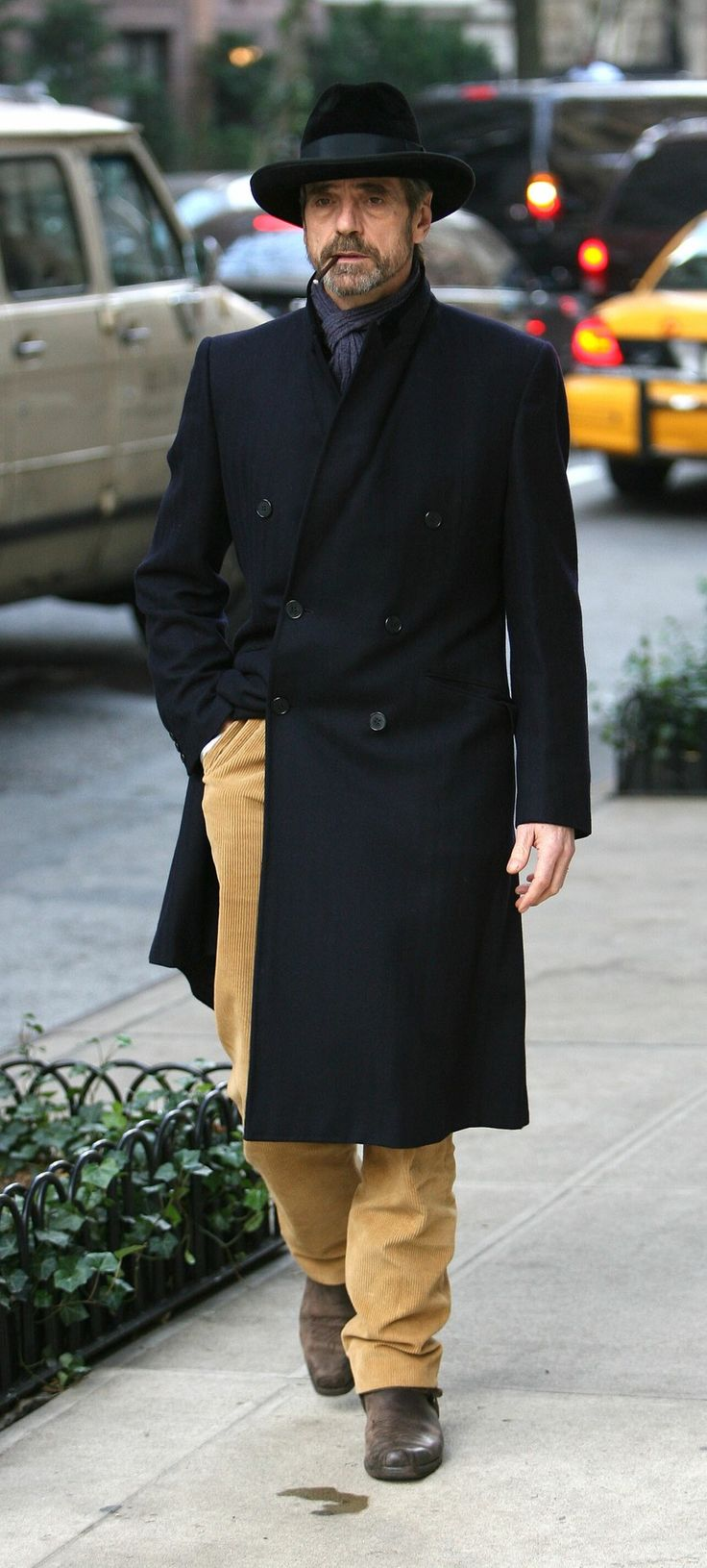 the hat, the pipe, the coat ... Jeremy Irons, looking quite stylish as he walks home - London