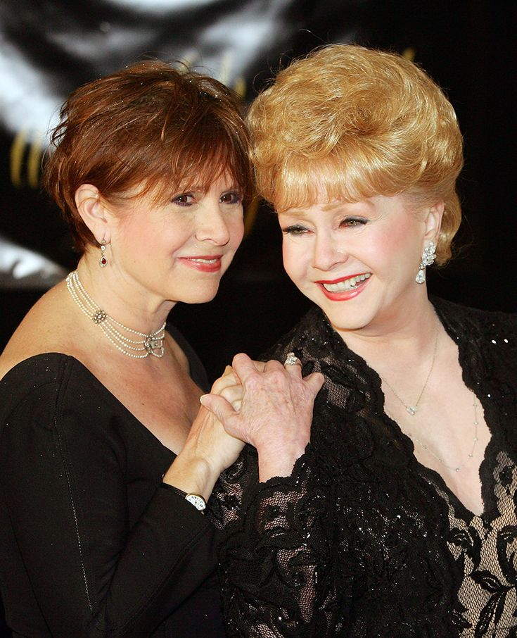 Liz's Party from Debbie Reynolds & Carrie Fisher's Mother-Daughter Moments  The twoarrive for Elizabeth Taylor's 75th birthday party at the Ritz-Carlton, Lake Las Vegas in Henderson, Nevada in 2007.Taylor was Debbie's friend andwas also the second ex-wife of herex-husband and Carrie's father,Eddie Fisher.