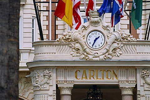 Clock and flags at the Carlton Hotel, Cannes, Alpes Maritimes, Provence, French…