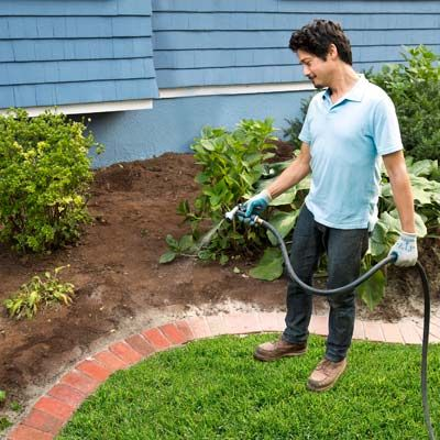 With the hose, wash the edging with a gentle spray, dampening the sand between the bricks without dislodging it. As the sand absorbs water, it will set, acting like grout to lock the bricks in place for years to come.
