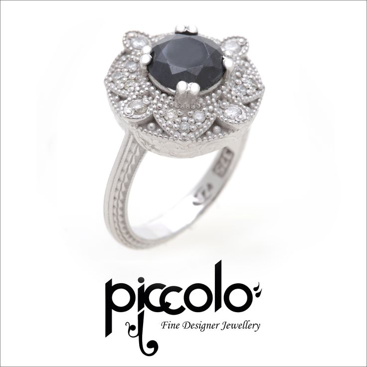 Florence | Brilliant Round Cut Black Diamond surrounded by a detailed Halo of White Diamonds, set in White Gold For a free consultation to design your unique custom dress ring, send us an email | info@piccolo-jewellery.co.za #halo #diamonds #blackdiamond #dressring #rings #jewellery