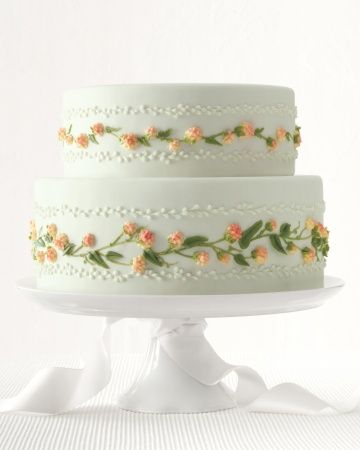 Can you guess the flavor of this show-stopping cake? Click for the recipe! #marthastewartweddings
