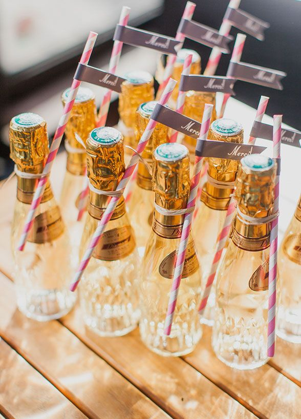 Mini champagne bottles, complete with striped straws, will help keep the party going even once open bar closes.