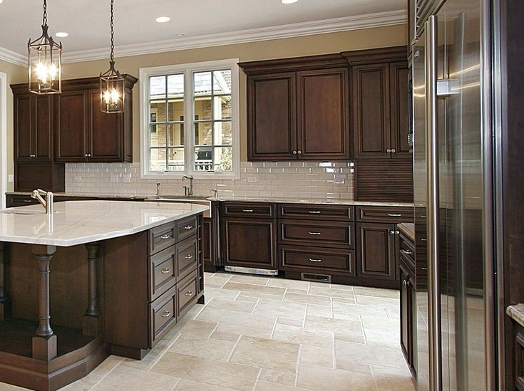 Stained cabinets, white tile floors | Dark brown kitchen ...