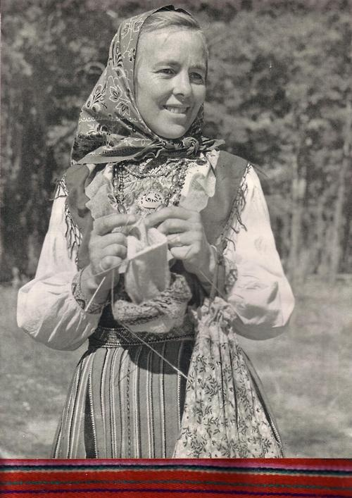 A Kihnu woman knitting. Photo by K. Oras. 1961 You can see a little ribbon showing the colors of her skirt under the picture.