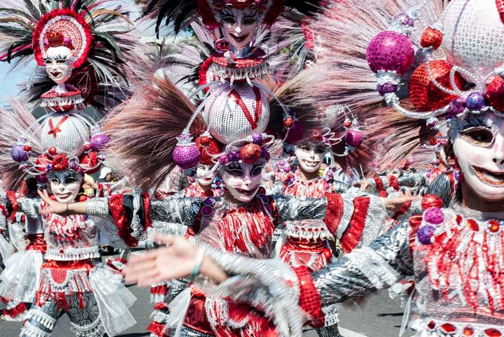 Masskara Festival - Every October, the people of Bacolod City in the Philippines get colorful with the most extraordinary costumes, masks and headdresses. Born out of a maritime tragedy to mourn the loss of 700 lives, the festival remembers the dead through celebrations.