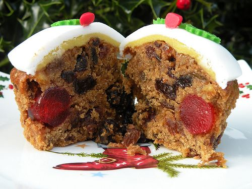 "Christmas fruitcake cupcakes; only I'd make fruitcake w/ like REAL Amarena cherries from Italy, and carmelized pineapple, stuff like that, not like the ""fruitcake"" everybody here is so afraid of..."