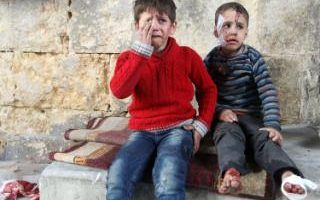 Injured boys react at a field hospital after airstrikes on the rebel held areas of Aleppo, Syria November 18, 2016.