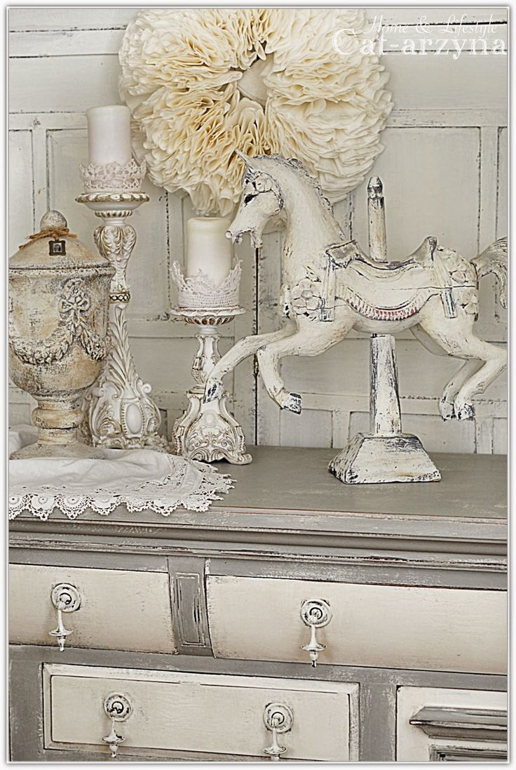 Love it all...the painted dresser, the candle sticks the doily and the urn..and of corse the painted HORSE!