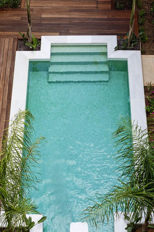 Very modern twist on a pool for a mermaid but the lovely steps and palms make it beautiful.
