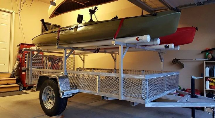 This custom aluminum trailer was built to carry two Hobie Outbacks and one PA 14