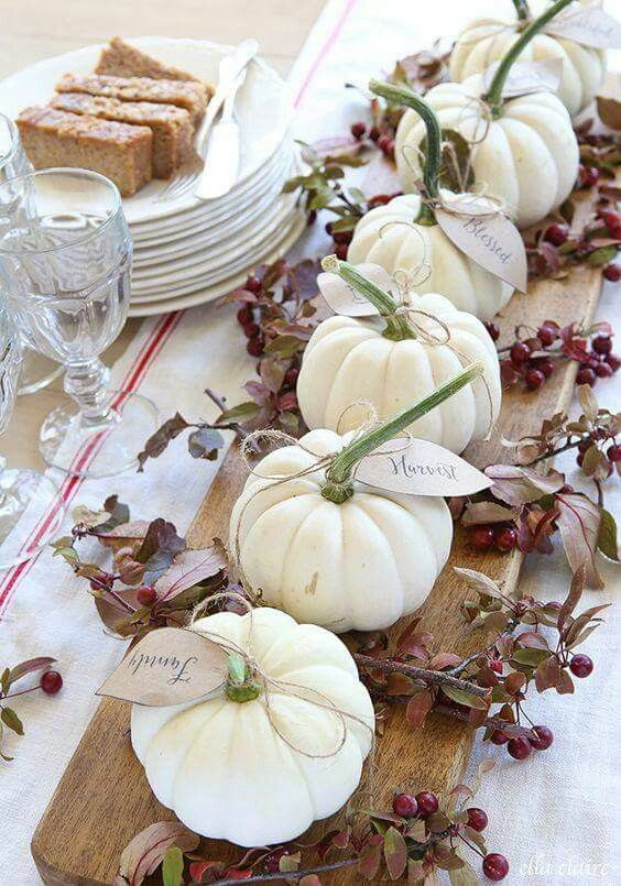 white pumpkin on wood board centerpiece