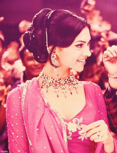 Deepika Padukone b. 5 January 1986 in Copenhagen, Denmark, is an Indian film actress and model. She has established a successful career in Hindi Bollywood films. She is the daughter of Indian badminton player Prakash Padukone. Here she is in her debut role in Om Shanti Om.