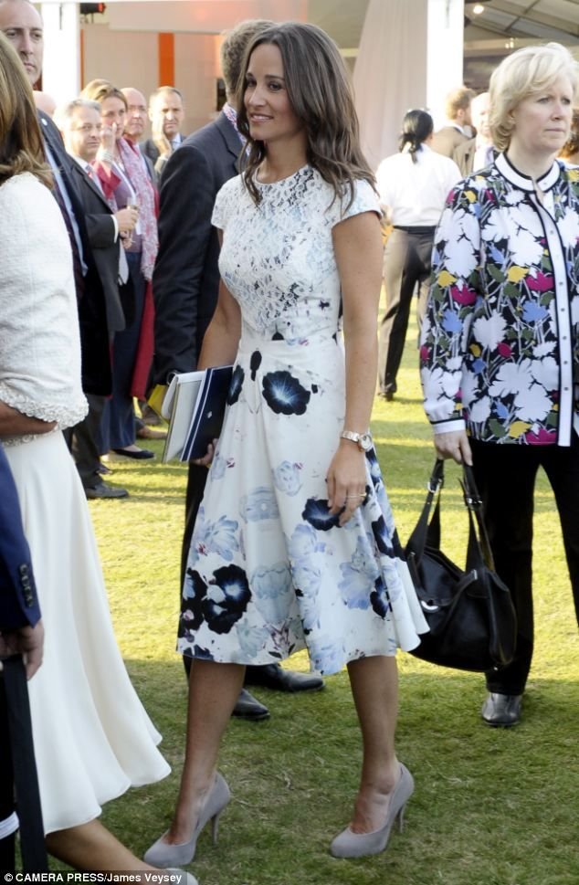 Pippa Middleton wore a Tabitha Webb floral dress. http://www.dailymail.co.uk/femail/article-2361688/Pippa-Middleton-wears-blue-white-floral-summer-outfuit-Queens-Coronation-Festival-Buckingham-Palace.html