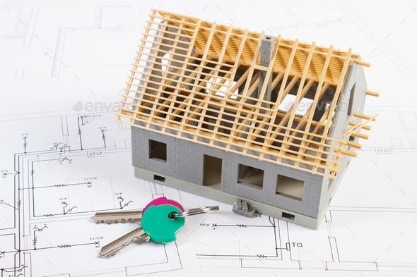 Home Keys And Small House Under Construction On Electrical Drawings Building Home Concept By Ratmaner Home Keys And Small House Un House Under Construction Business Design Building A House