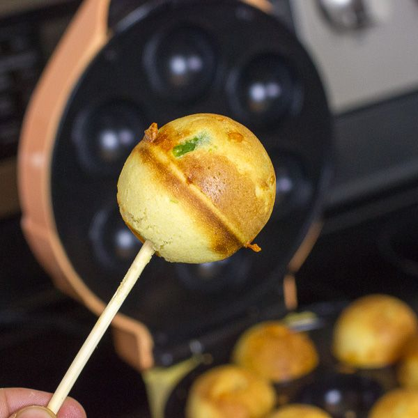 Cheddar Jalapeno Cornbread Cake Pop: 1 c corn meal, 1 c flour, 4 tsp baking powder, ½ tsp salt, ¼ c sugar, 1 egg, 1 c milk, ¼ c oil, 2 jalapeno peppers, 1 c grated cheddar cheese.