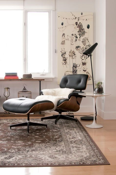 The Eames Lounge Chair And Ottoman By Herman Miller Are Accompanied