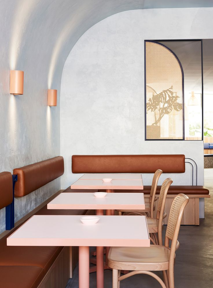 The interior by Studio Esteta ticks off a number of trends—terrazzo, rattan, arches, a Barragánian color palette—but remains grounded by humble textures.