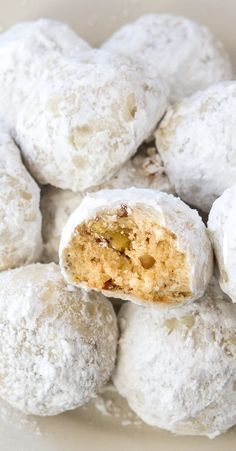 Snowball Christmas Cookies Recipe - The best buttery, pecan shortbread cookie (sometimes called Russian Teacakes or Mexican Wedding Cookies). You're going to adore these classic snowball Christmas cookies this holiday! #Christmas #ChristmasCookies #Desserts