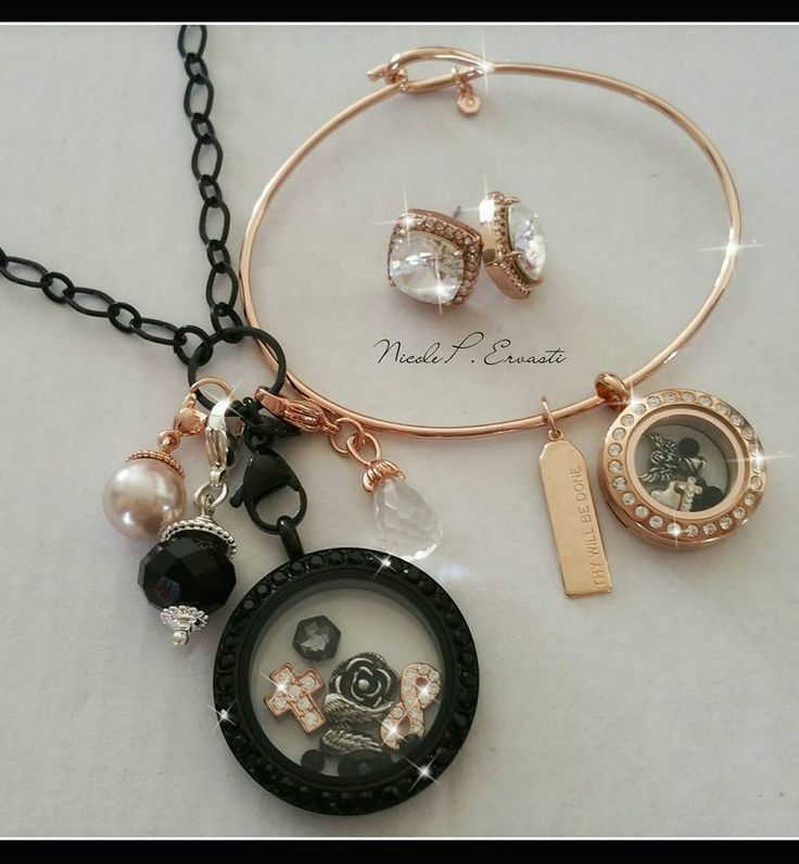 Who loves black and gold?  This is the complete package, earrings, bangle bracelet, lockets, dangles, necklace, and charms!  Beautiful jewelry!