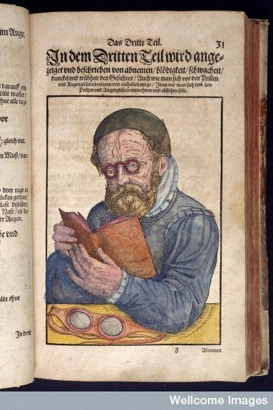 illustration shows early example of eyeglasses being worn while reading a book, in medieval book [Ophthalmodouleia] Das ist Augendienst, by Georg Bartisch, published Dresden, Germany, 1583 / Wellcome Library, London, UK