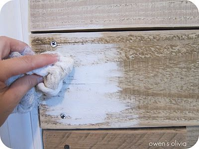 Whitewashed Wood Technique  1 part paint  2 parts water   Paintbrush  Cup  Dry cloth   I sanded my boards with 80 grit paper before application  Mix your paint and water together  DO NOT apply paint to the entire surface you are working  Using your cloth, rub the paint in the direction of the wood grain  You should be able to spread it out easily.  For my project, I left some of the original color on the boards, so I wasn't getting into every nook and cranny.