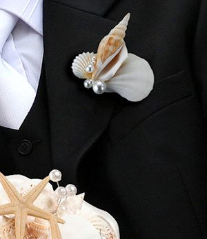Coastal Sea Shell Boutonniere (Lillian Rose BT440) | Buy at Wedding Favors Unlimited (http://www.weddingfavorsunlimited.com/coastal_sea_shell_boutonniere.html).