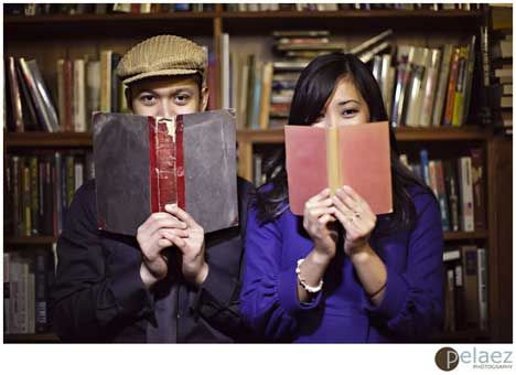 engagement photo shoot in a bookstore or a library